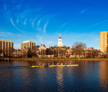 A Harvard Crimson Lightweight Crew practicing for a contest in Charles River in Cambridge, Massachusetts, USA