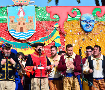 Typical carnival chorus (chirigota) sing during the carnival in the streets in el Puerto de Santa Maria Spain.
