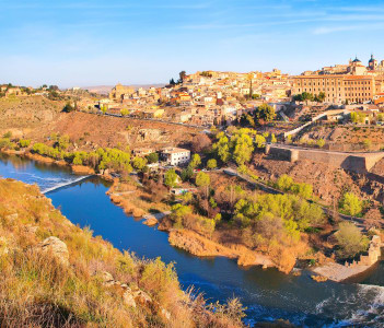 Panoramic view of the historic city of Toledo with river Tajo at sunset in Castile-La Mancha Spain