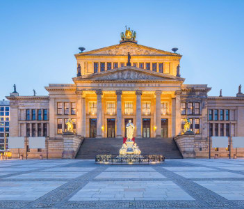 Panoramic view of famous Gendarmenmarkt square with Berlin Concert Hall in twilight during blue hour at dusk Berlin Mitte district Germany