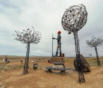 high sculpture Iron Man, symbol of the city of Darkhan
