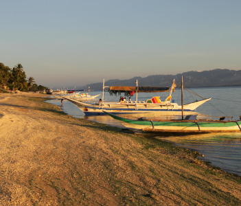 Bangkas in the sunset of Carabao Island in Philippines