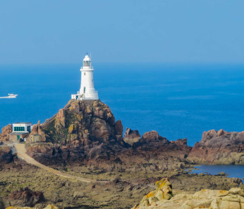 La Corbiere Lighthouse on the rocky coast of Jersey