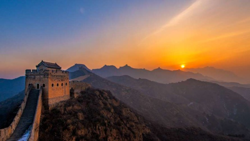 Watch the sun dip behind the soft Chinese hills