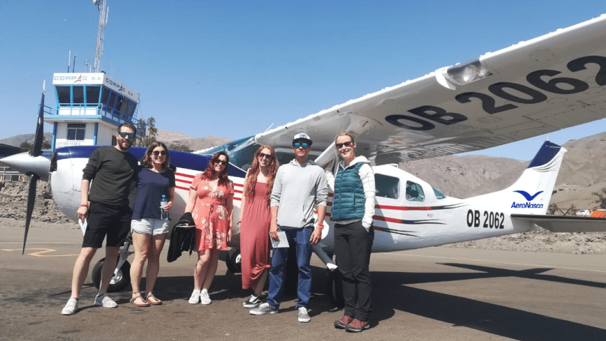 Happy travellers outside the AeroNasca