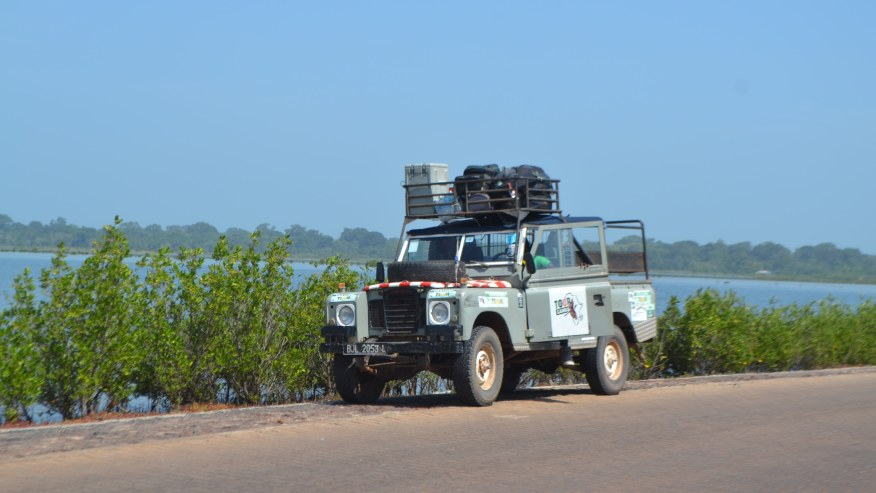 Make your way through the bustling towns along River Gambia