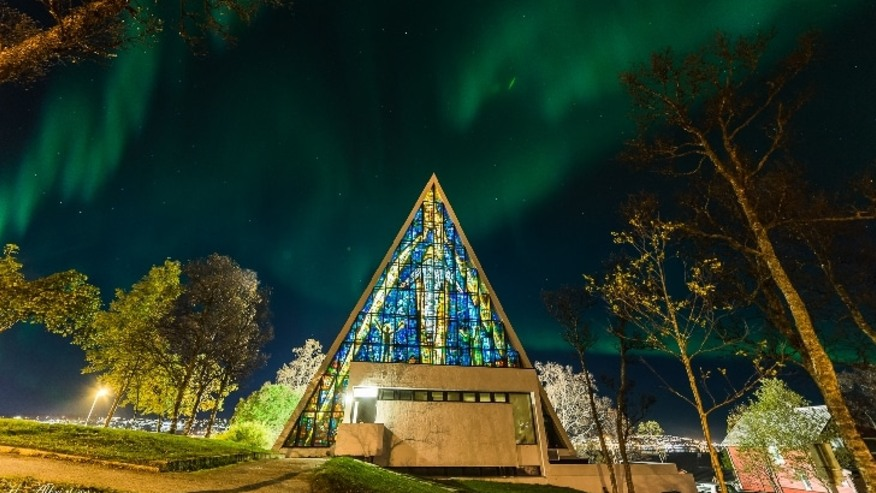 The Arctic Cathedral flanked by the glamorous Northern Lights