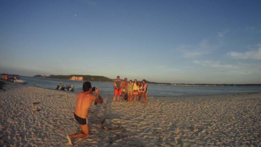 People posing for a photo at the beach
