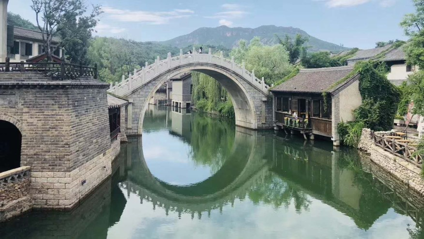 Notice the perfect circle formed with the reflection of this arched bridge