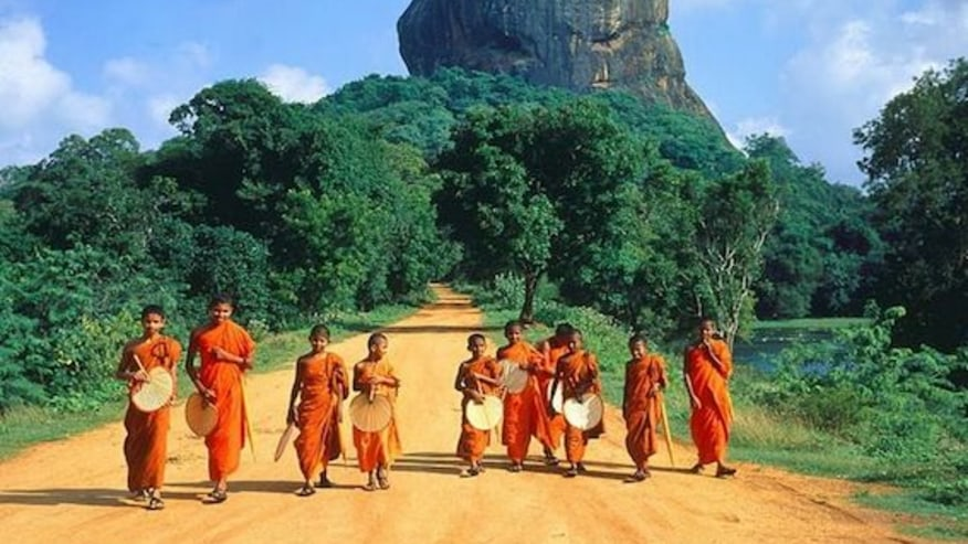 Buddhist monks at lion rock