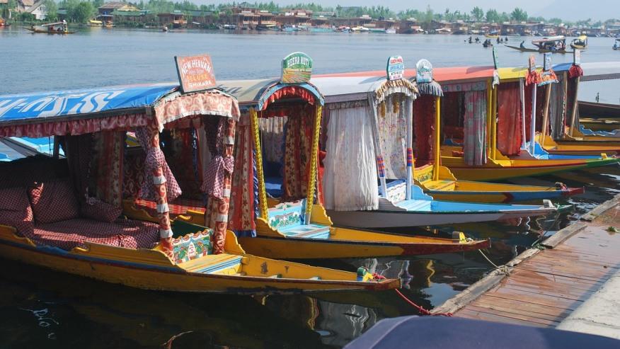 Kashmiri Shikaras near the lake.