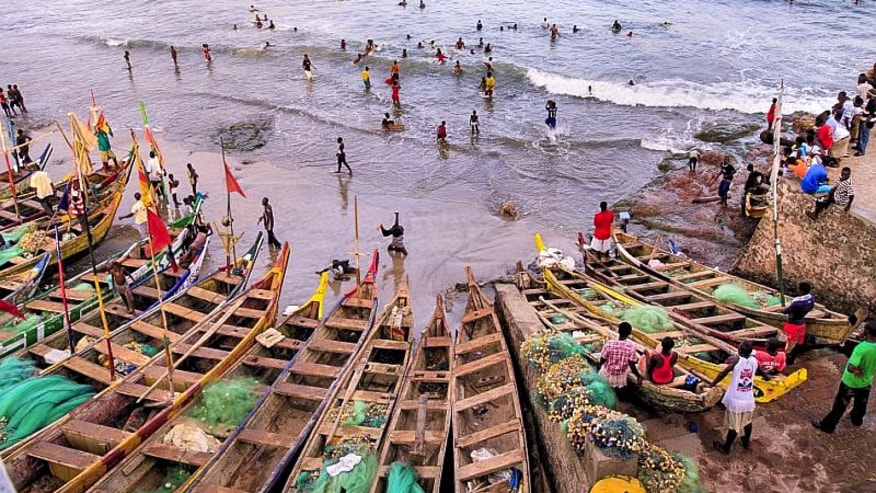 Canoes at the shores of cape coast castle