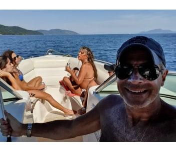 Cruising on a motor boat to Saco do Céu