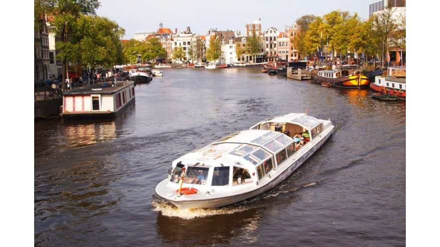 Hop-on Hop-off canal cruise boat on Amstel river