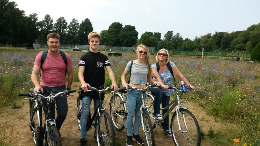Family cycle though the Wild meadows in Preston Park, Brighton
