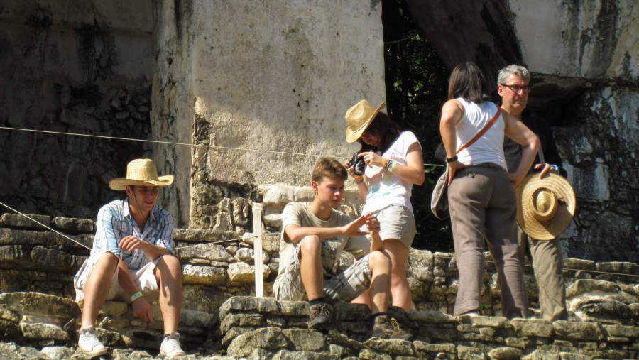 French Family teking a break in Palenque Cross Temple