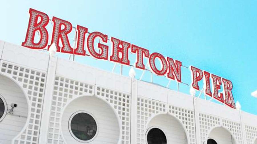 Cycle right infront of the Brighton pier on the Brighton Bike Tour