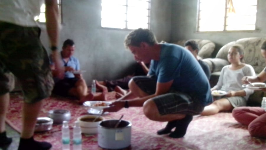 A spice lunch at the village. Of course  we all become locals. Serve yourself then extra fruits as dessert!!