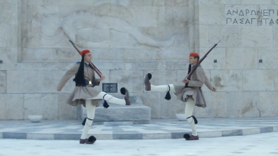 The main attraction at Syntagma Square is the House of Parliament, originally built in 1842 as the Royal Palace. Evzones, members of the presidential guard dressed in traditional uniforms stand vigil at the Tomb of the unknown soldier in front of the parliament.