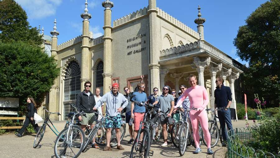 A Stag party on the Brighton Bike Tour have there photo taken infront of the Royal Pavilion Palace