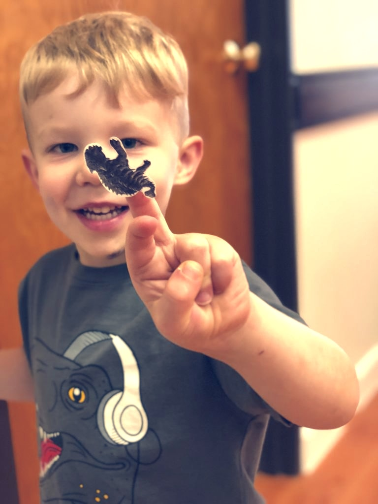 Boy showing sticker
