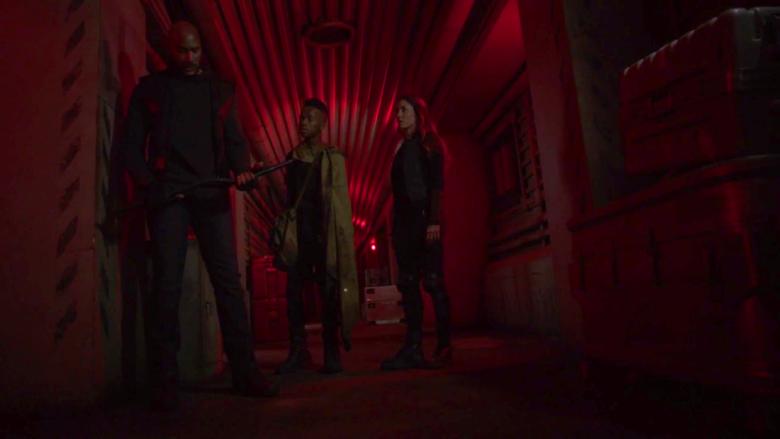 Mack, Elena, and Flint sneak through corridors