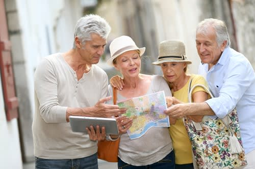 Seniors traveling and looking at a map