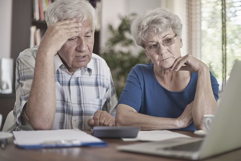 Senior couple concerned while calculating finances