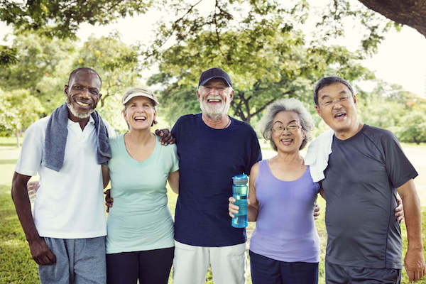 A group of seniors smiling after outdoor exercise