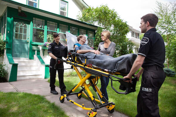 Woman taken from her home on a stretcher by paramedics