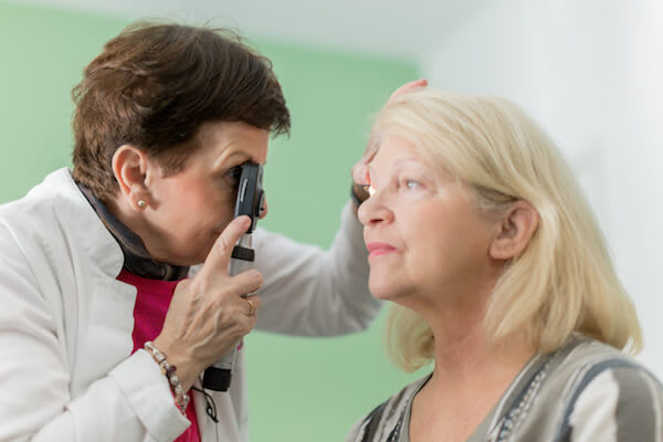 Woman gets an eye exam from her doctor