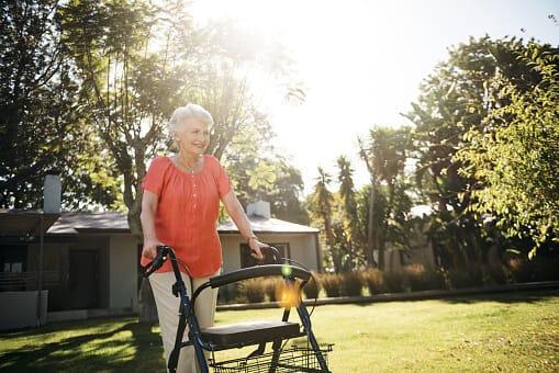 Woman using a walker outside