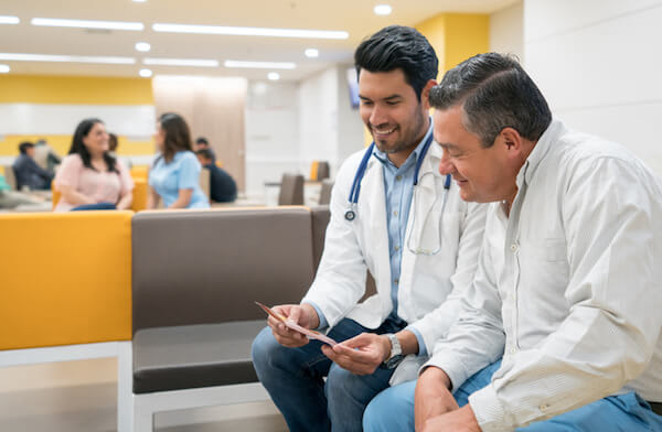 Doctor and patient sit down and review information
