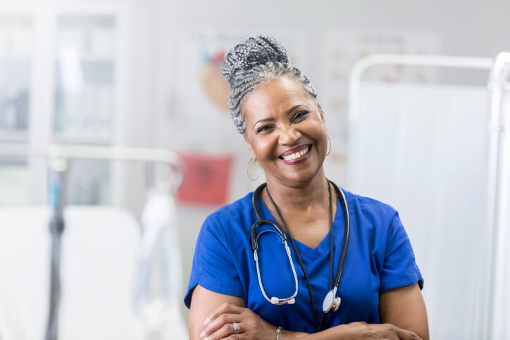 A nurse smiles in the hospital