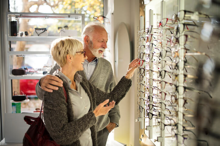 A couple shopping for glasses in a vision care store
