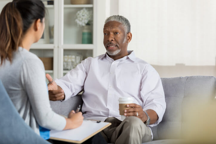 Man receives counseling from his therapist