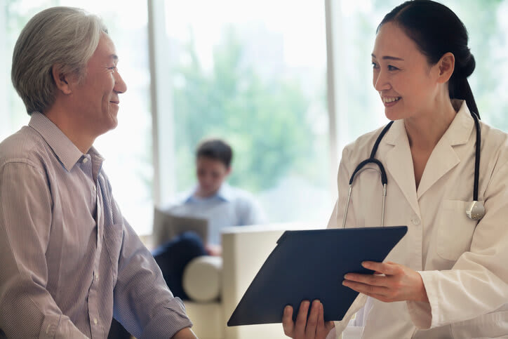 Doctor reviews information with patient