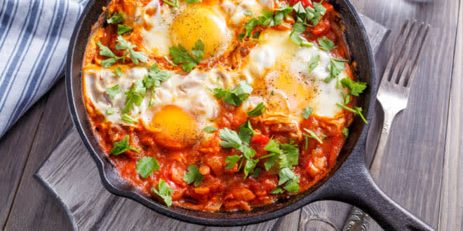 Shakshuka in a frying pan is one of the most typical Israeli eats.
