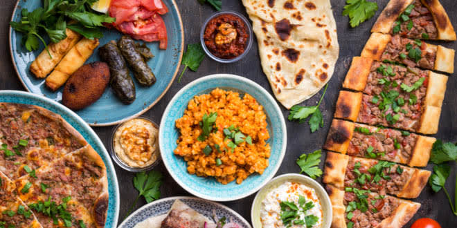 Variety of traditional Turkish dishes such as Turkish pizza, meat kebab, pita, bulgur and hummus.