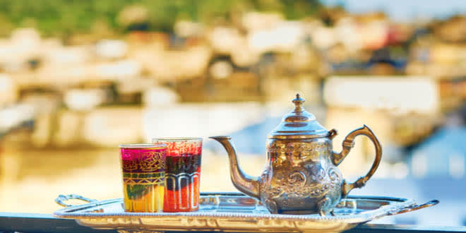 Tray with traditional Moroccan mint tea, ready for an afternoon snack.