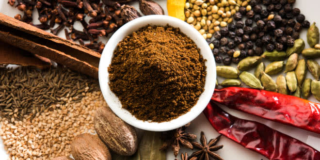 Garam masala powder and several colourful Indian spices.