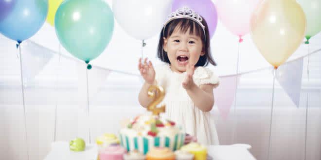 Little girl eating Hello Kitty DIY birthday cakes