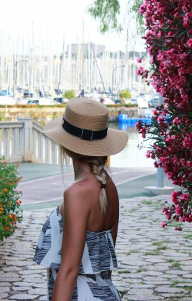 ESP.Woman overlooking harbour with flowers Couple walking along empty beach