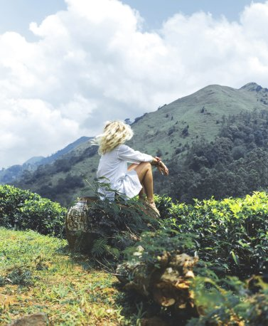 01_Woman atop hill in Tea Plantation