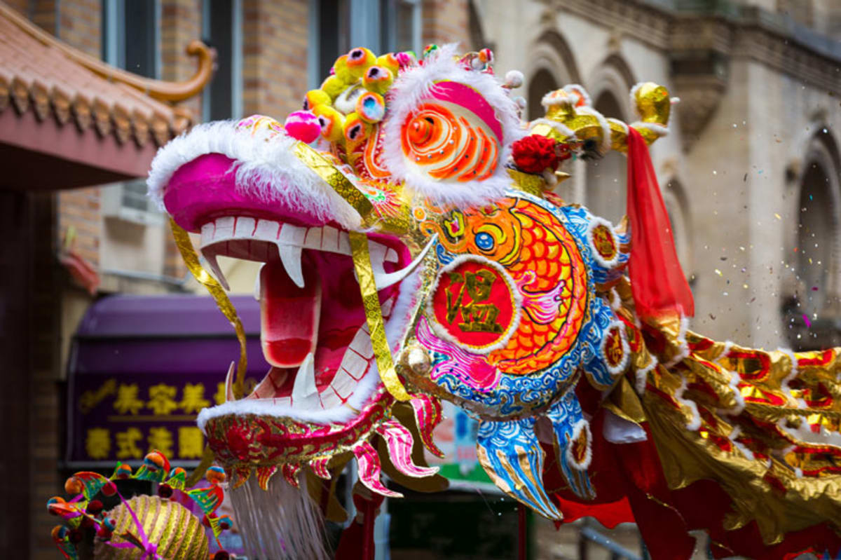 Colorful lion float in Chinese parade.