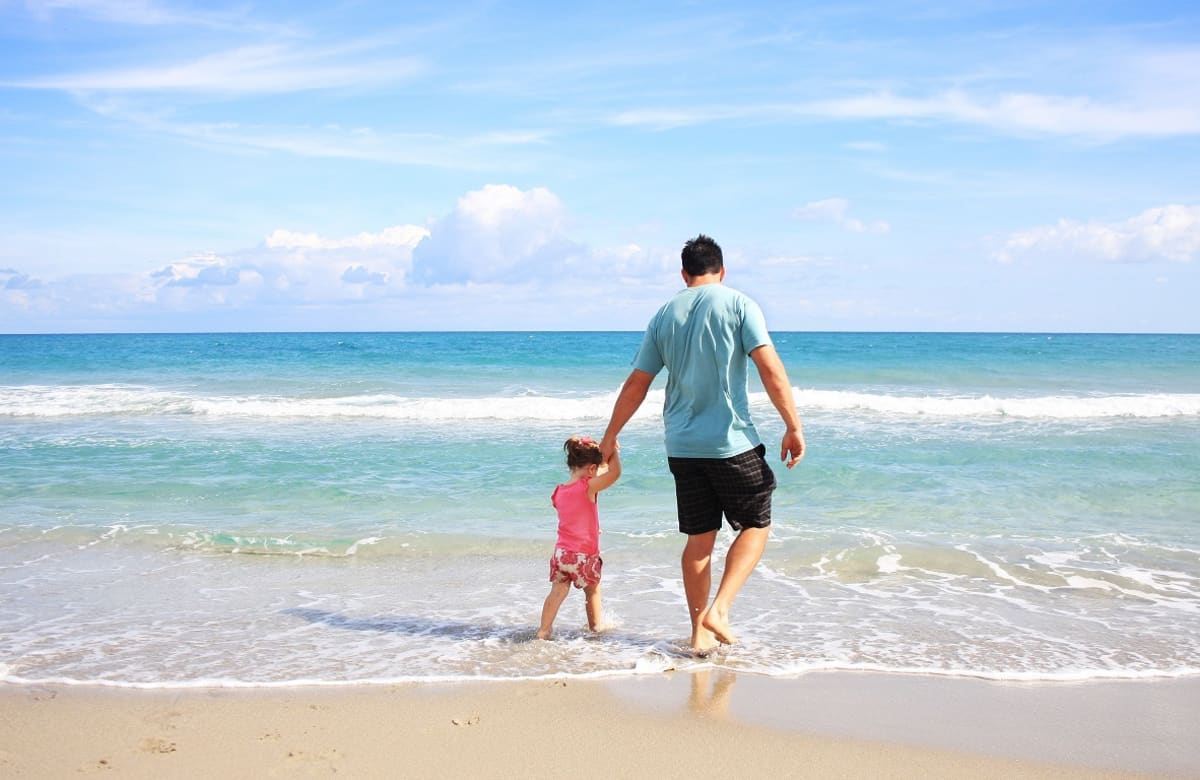 Dad and child at beach
