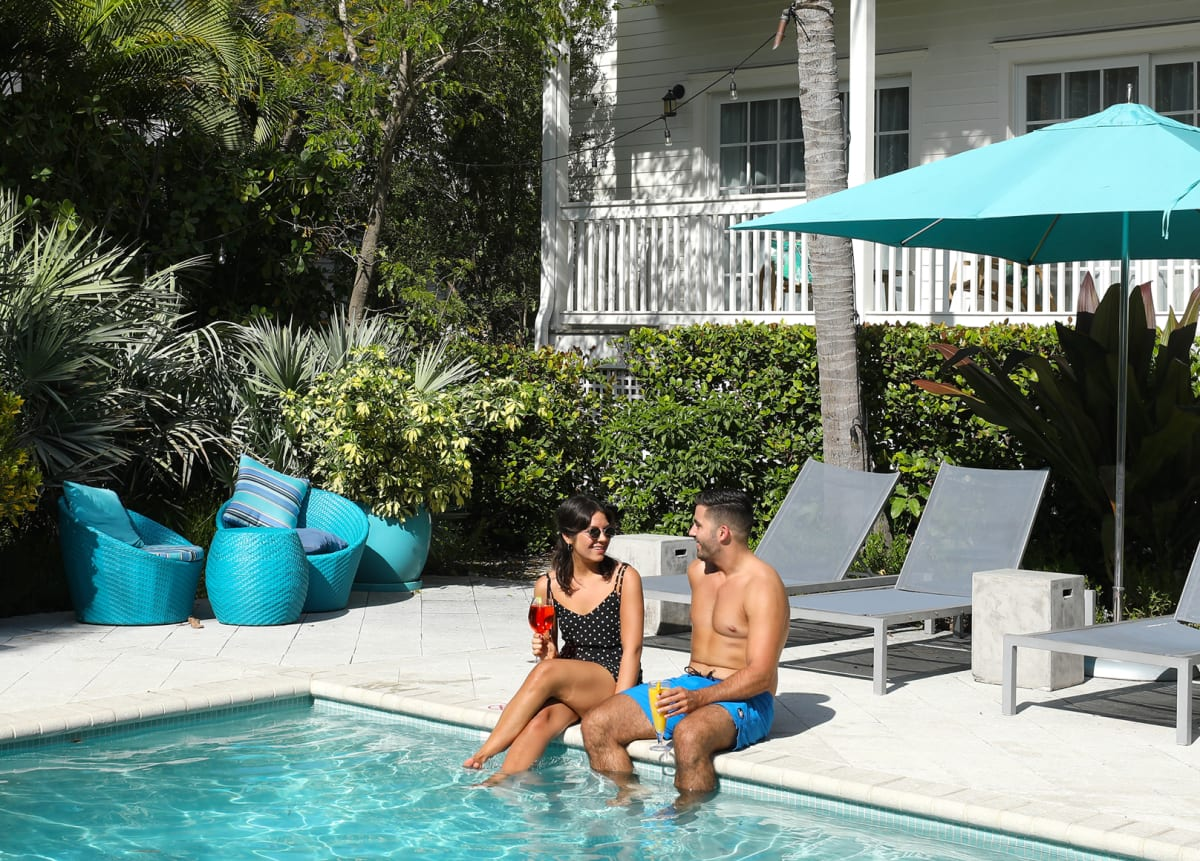 Couple sitting by the pool in Key West