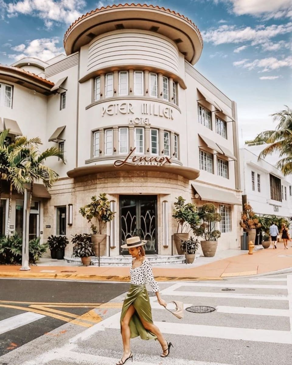 girl walking in front of the Lennox Miami Beach