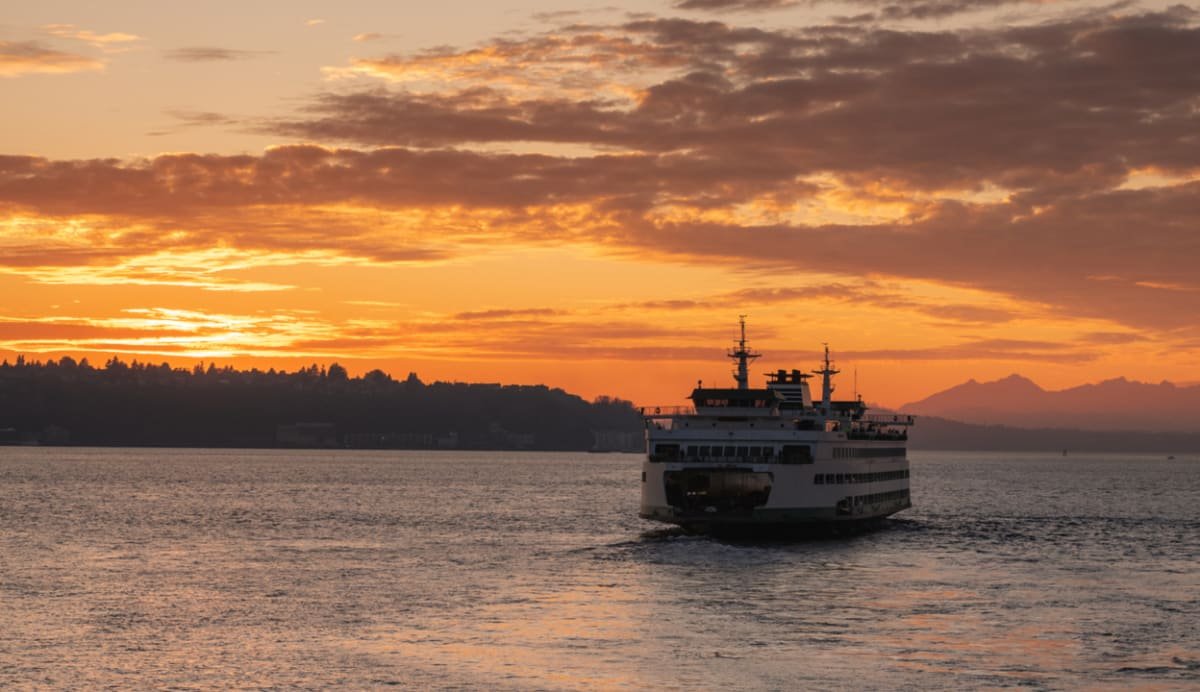 ferry with sunset in background