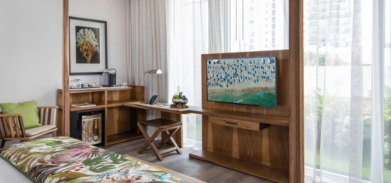 A 49-inch 4K TV is the centerpiece of the Balcony King Room